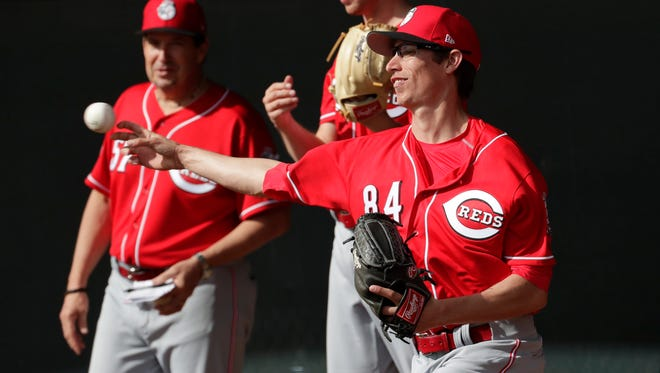 Cincinnati Reds' Jimmy Herget (84) throws during the teams' first day of spring training baseball workouts, Tuesday, Feb. 14, 2017, in Goodyear, Ariz. (AP Photo/Matt York)