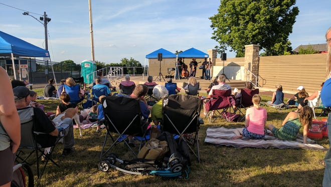 Residents gather for a performance by Comet Bluegrass All-Stars during the Price Hill Summer Concert Series. The next concert will be July 28 and feature the Tracy Walker Band.