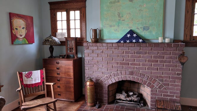 """The Pennells fell in love with the """"clinker"""" bricks used to build their fireplace, which a previous owner covered in stucco and mirrored glass tiles."""