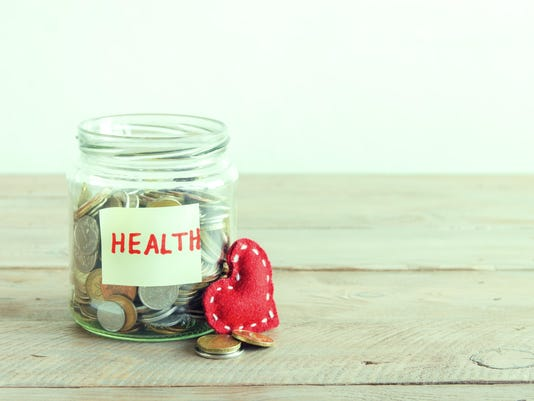 Coins in jar for Health