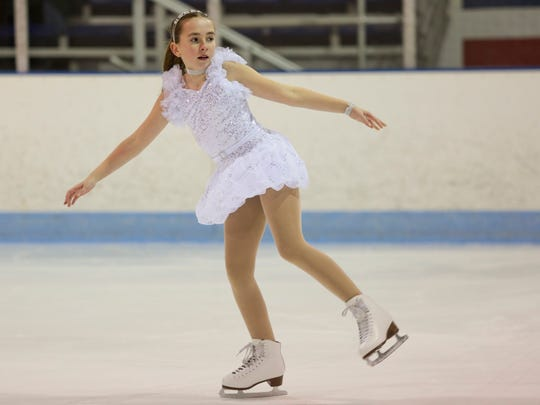 Grace Durica, 12, skates along with members of the Port Huron Figure Skating Club as they practice for their upcoming show.