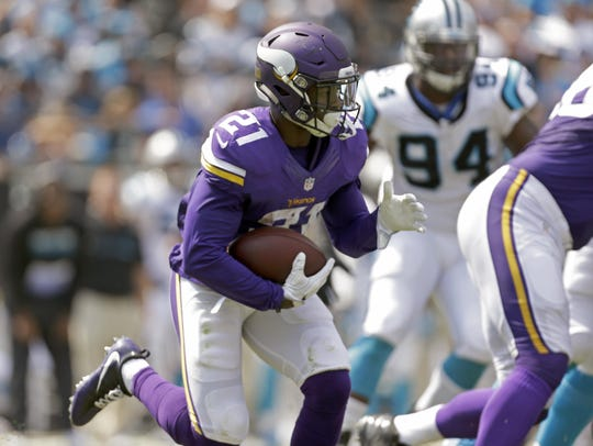The Minnesota Vikings' Jerick McKinnon (21) looks to