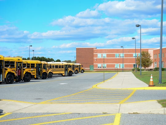 The Indian River School district buses sit outside