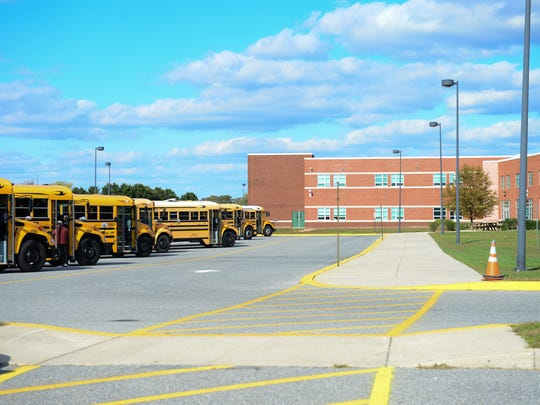 The Indian River School district buses sit outside Indian River High School on Tuesday, Oct. 26. 2016.