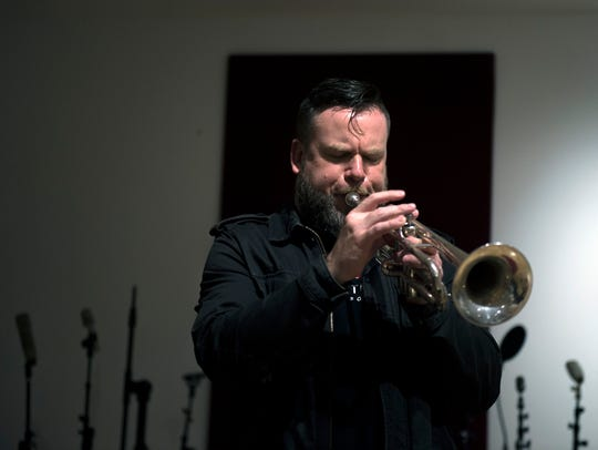 Matt Cappy of Collingswood plays his trumpet inside the Gradwell House recording studio in Haddon Heights. Cappy will be part of Saturday's lineup in Merchantville during the June installment of the East of Philly concert series.