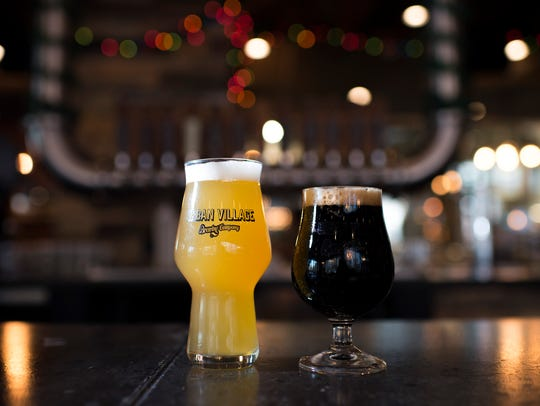 A 2nd Street blonde ale (left) sidles up to an Oatis oatmeal stout at Urban Village Brewing Company in Philadelphia.