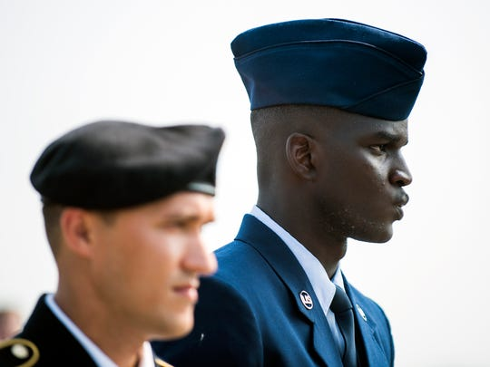 Alpha Tall, 22, (right) of Mali, Africa, stands alongside Yury Vasilyev as newly inducted citizens during a naturalization ceremony aboard the USS New Jersey Wednesday, July 4, 2018 in Camden, N.J.