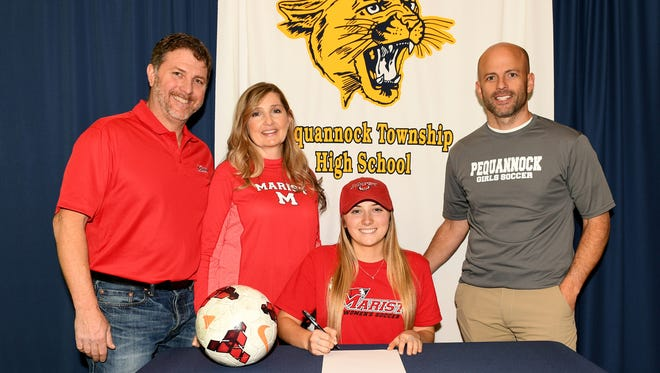 Pequannock girls' soccer standout Kayla Afflitto, center, signed her National Letter of Intent on Wednesday with Marist College with her parents and coach Jon McBurney, right, in attendance.