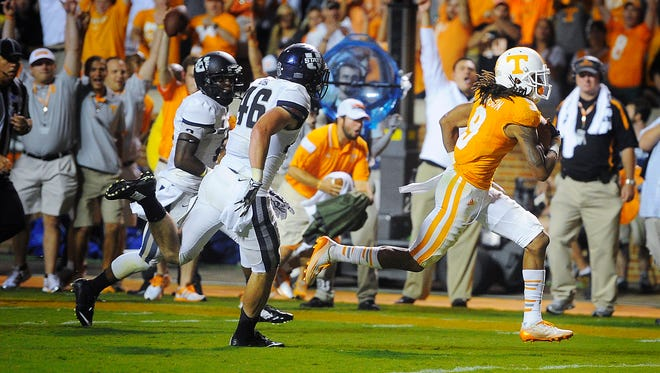 Tennessee wide receiver Von Pearson (9) runs in for a touchdown as the University of Tennessee plays Utah State at Neyland Stadium.  Sunday Aug. 31, 2014, in Knoxville, TN.