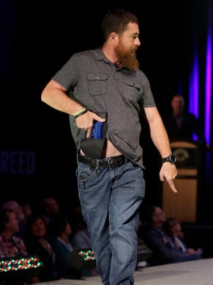A model walks the runway during the NRA Concealed Carry Fashion Show on Aug. 25, 2017, in Milwaukee, Wis.