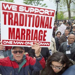 Participants in the March For Marriage protest outside the Supreme Court on April 25.
