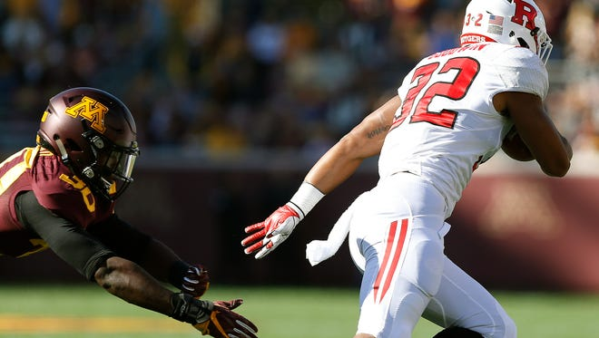 Rutgers running back Justin Goodwin outruns the grasp of Minnesota defensive back Eric Amoako during the first half an NCAA college football game Saturday, Oct. 22, 2016, in Minneapolis. (AP Photo/Stacy Bengs)