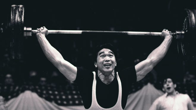FILE - In this May 17, 1958, file photo, Tommy Kono, of the United States, competes in a weightlifting match between the U.S. team and a visiting Russian team in New York.