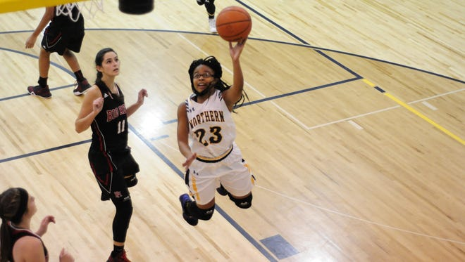 Port Huron Northern's Olivia Ramsey makes a layup against Port Huron on Dec. 9, 2016.