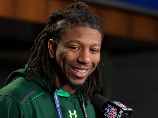 Kentucky linebacker Bud Dupree talks with reporters during a news conference at the NFL football scouting combine at Lucas Oil Stadium in Indianapolis, Friday, Feb. 20, 2015. (AP Photo/Doug McSchooler)
