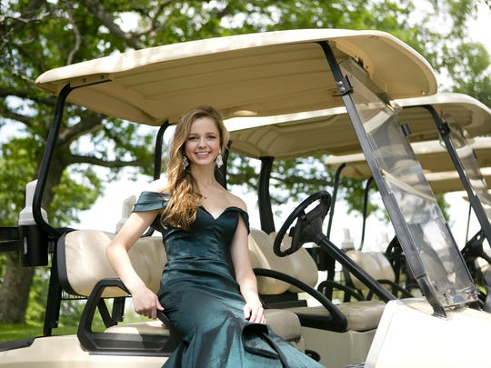 Miss Wisconsin Rapids Area Madeline Kumm poses in her formal gown on a golf cart at Bull's Eye Country Club in Wisconsin Rapids, Wednesday, June 10, 2015.
