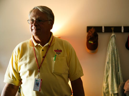 Iowa State Fair Board member Jerry Parkin gives a tour of the residences at the Administration building on the grounds of the Iowa State Fair on Aug. 11.