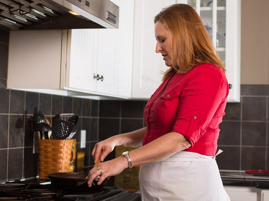 Ellen Adams cooks at her home in Webster.