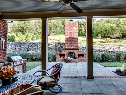 The covered porch out back is fabulous for family gatherings.
