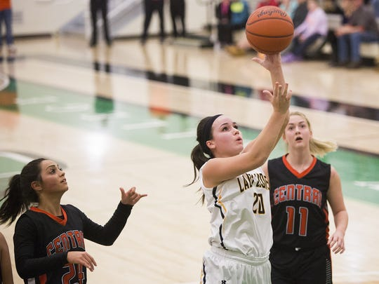 Red Lion's Amy Maciejewski drives to the hoop. Red Lion defeats Central York 35-34 in the YAIAA girls' basketball championship game at York College, Friday, February 12, 2016.