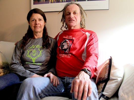 Clay Shaw, 65, and Karen Mitchell, 64, sit at their home in January in York County. Both are long-distance marathon runners.