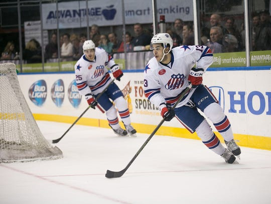Amerks forward Nick Baptiste carries the puck in the