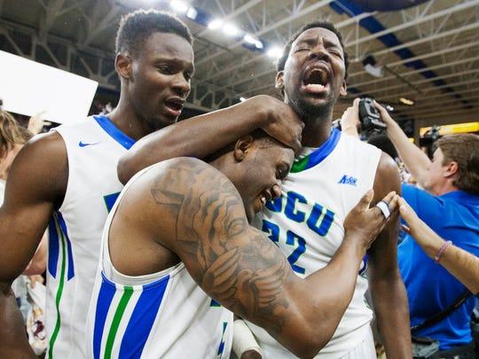 FGCU's Demetris Morant, left, Antravious Simmons, top, and Zach Johnson celebrate beating Stetson in the Atlantic Sun Conference Championship game Sunday at Alico Arena in Fort Myers. FGCU beat Stetson 80-78 to advance to its second NCAA Division I basketball tournament in school history.