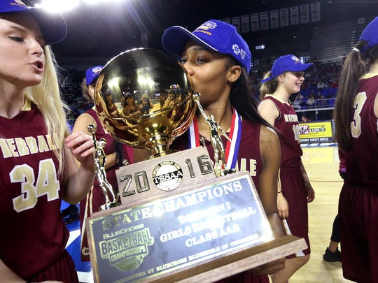 Riverdale's Anastasia Hayes, right, kisses the state