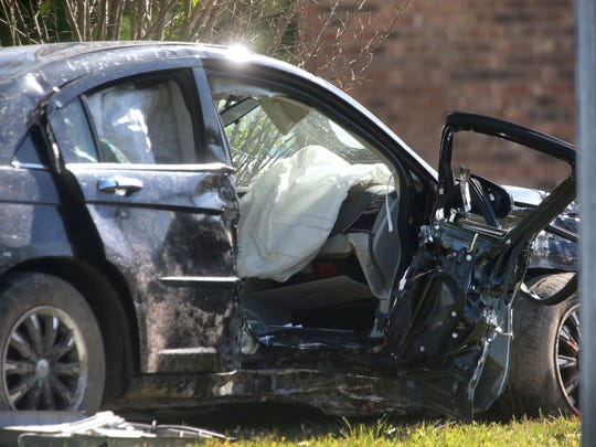 The accident scene,Tuesday, April 12, 2016, on Warrior Drive near Riverdale High School following a high speed chase resulting in a crash.