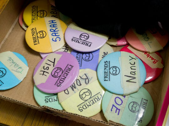 Volunteer name badges at Friends of the Tompkins County Public Library Book Sale.