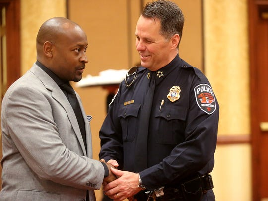 Pastor James McCarroll, the minister at First Baptist Church-East Castle Street, talks with Murfreesboro Police Chief Karl Durr at the 2016 Mayor's Prayer Breakfast. This year's event will be held at lunchtime in conjunction with World Outreach Church's National Day of Prayer commemoration.