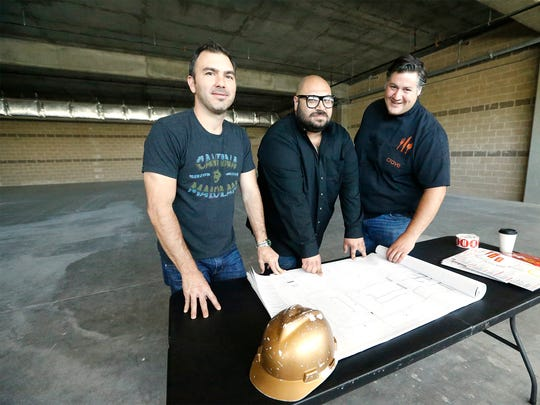 Octavio Gomez, Nick Salgado and Rudy Valdes owners of the three Crave Restaurants in El Paso go over the floor plans for their newest location at the Fountains of Farah, which they expect to open during the fall of 2016.