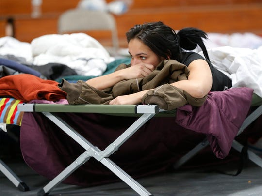 An unidentified Cuban refugee rests at the Houchen