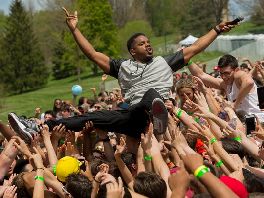 Theron 'Uptown AP' Thomas, of R. City, goes crowd surfing Thursday afternoon at Slope Day, the last day of classes at Cornell University.