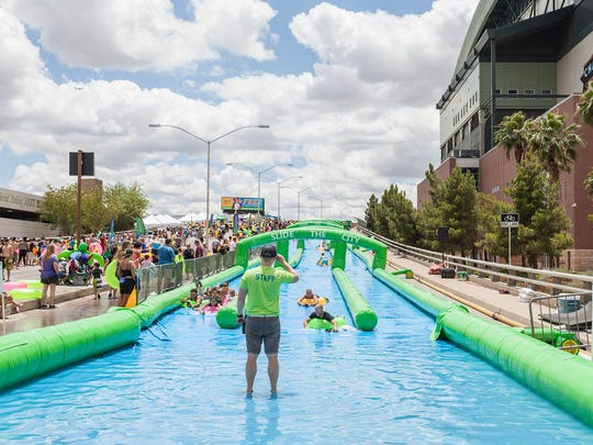 Slide the City gives Valley residents a chance to go on a waterslide in downtown Phoenix.