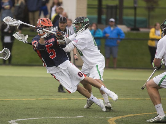 Gettysburg's Mike Distler, left, scores the game-winning