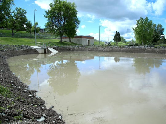 A sludge basin sits on site at the Great Falls Water Treatment Plant on May 24. The impurities cleaned out of the water go into the basins instead of being deposited back into the river.