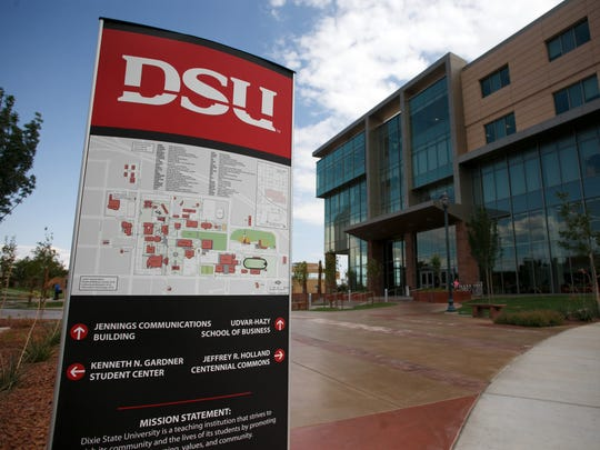 A sign in front of the Holland Building on the campus of Dixie State University.