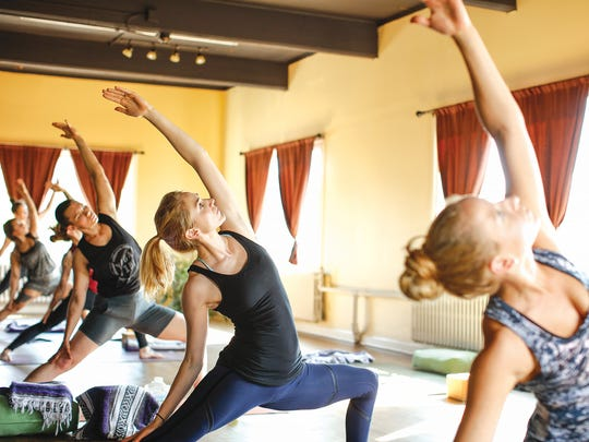 A class at YogaVibe Rochester, which offers all sorts of yoga.