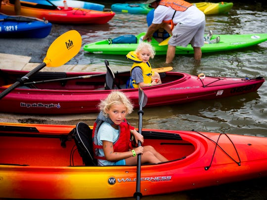 Paddlefest participants get into their kayaks and canoes at the launch point at Schmidt Recreation Complex for the 15th Annual Paddlefest Saturday, August 6, 2016.