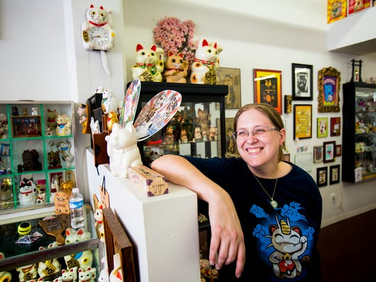 Micha Robertson poses for a portrait at the Lucky Cat Museum at Essex Studios in Walnut Hills.
