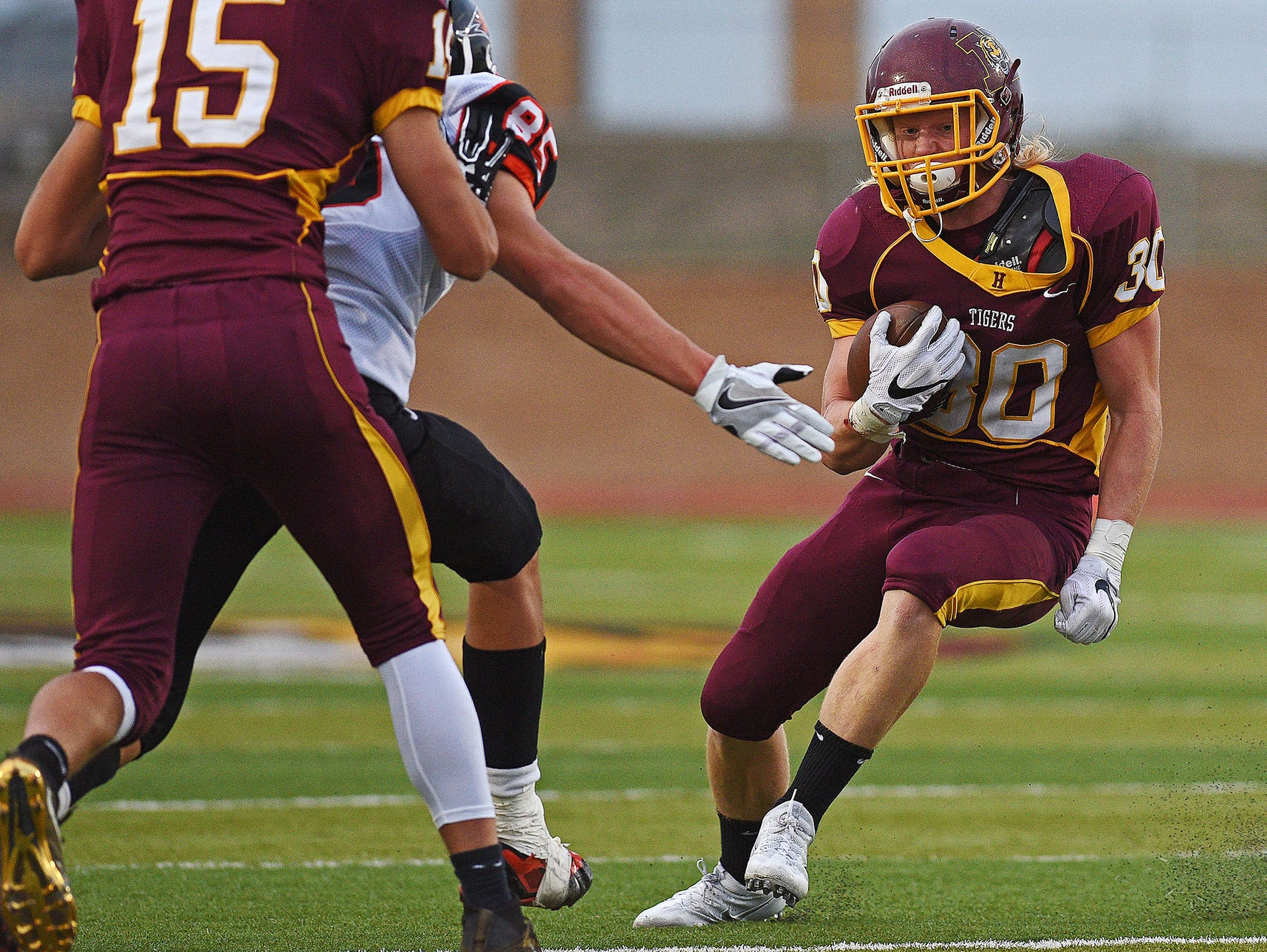 Harrisburg's Jack Anderson (30) rushes with the ball during a game against Huron at Harrisburg High School Friday, Sept. 2, 2016, in Harrisburg, S.D.