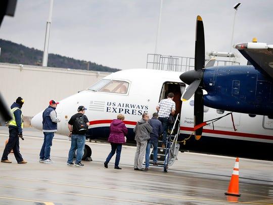 Passengers board an American Airline's U.S. Airways
