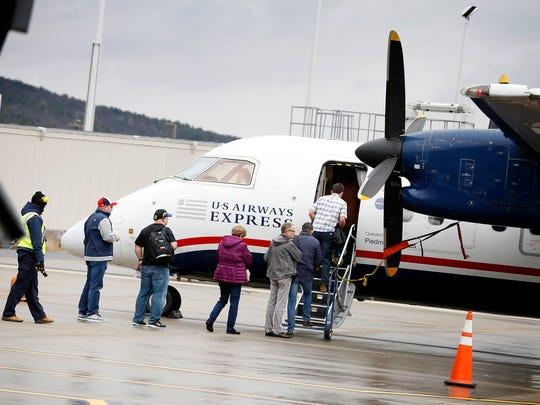 Passengers board an American Airline's U.S. Airways Express plane headed to Philadelphia from the Elmira Corning Regional Airport on Dec. 2.