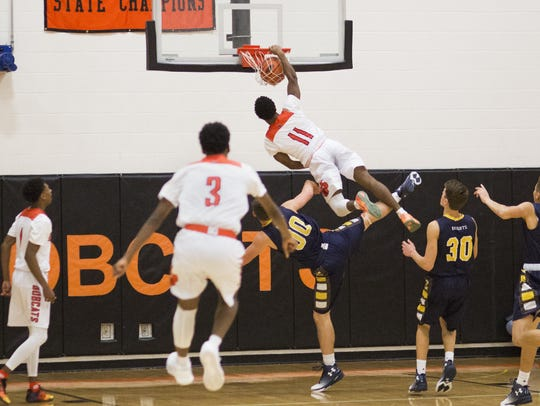 Northeastern's Fred Mulbah hammers home a dunk against
