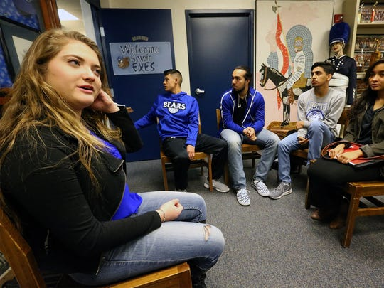 Veronica Rodriguez, left, and other Bowie seniors discuss their plans for the OSO Good food truck in the Bowie Heritage Room on campus.