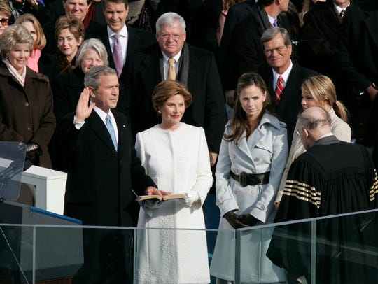 President George W. Bush is sworn in with his hand