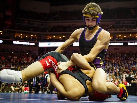 WaukeeÕs Kyle Biscoglia wrestles Jacob Schipper of
