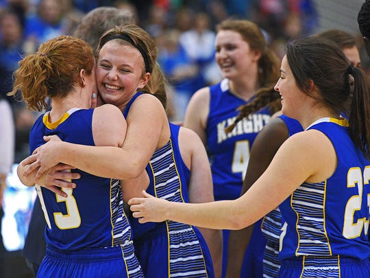 O'Gorman players, including Ashlee Beacom (13) and Abigale Muller (4), celebrate their team's 53-48 overtime win over Harrisburg in the 2017 SDHSAA Class AA State Girls Basketball championship game Saturday, March 18, 2017, at Rushmore Plaza Civic Center in Rapid City.