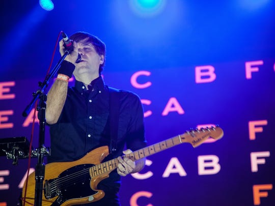 Fans watch bands such as Death Cab for Cutie and X